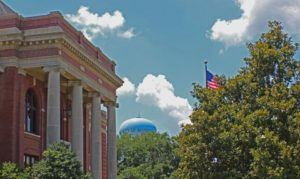 Courthouse, water tower, flag